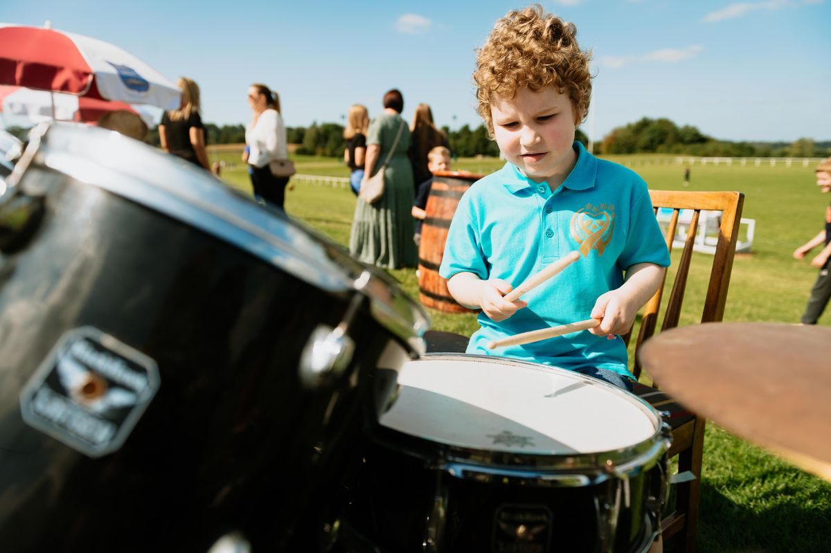 Having a go on the drums