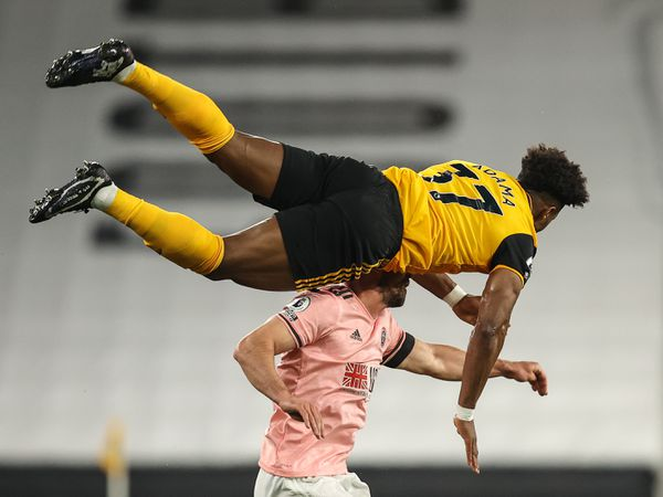 Adama Traore is upended after an aerial challenge in the victory over Sheffield United (AMA)