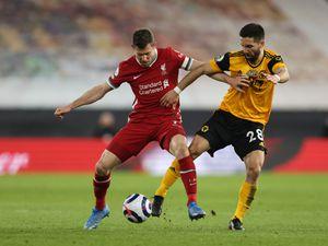 James Milner of Liverpool and Joao Moutinho of Wolverhampton Wanderers (AMA)