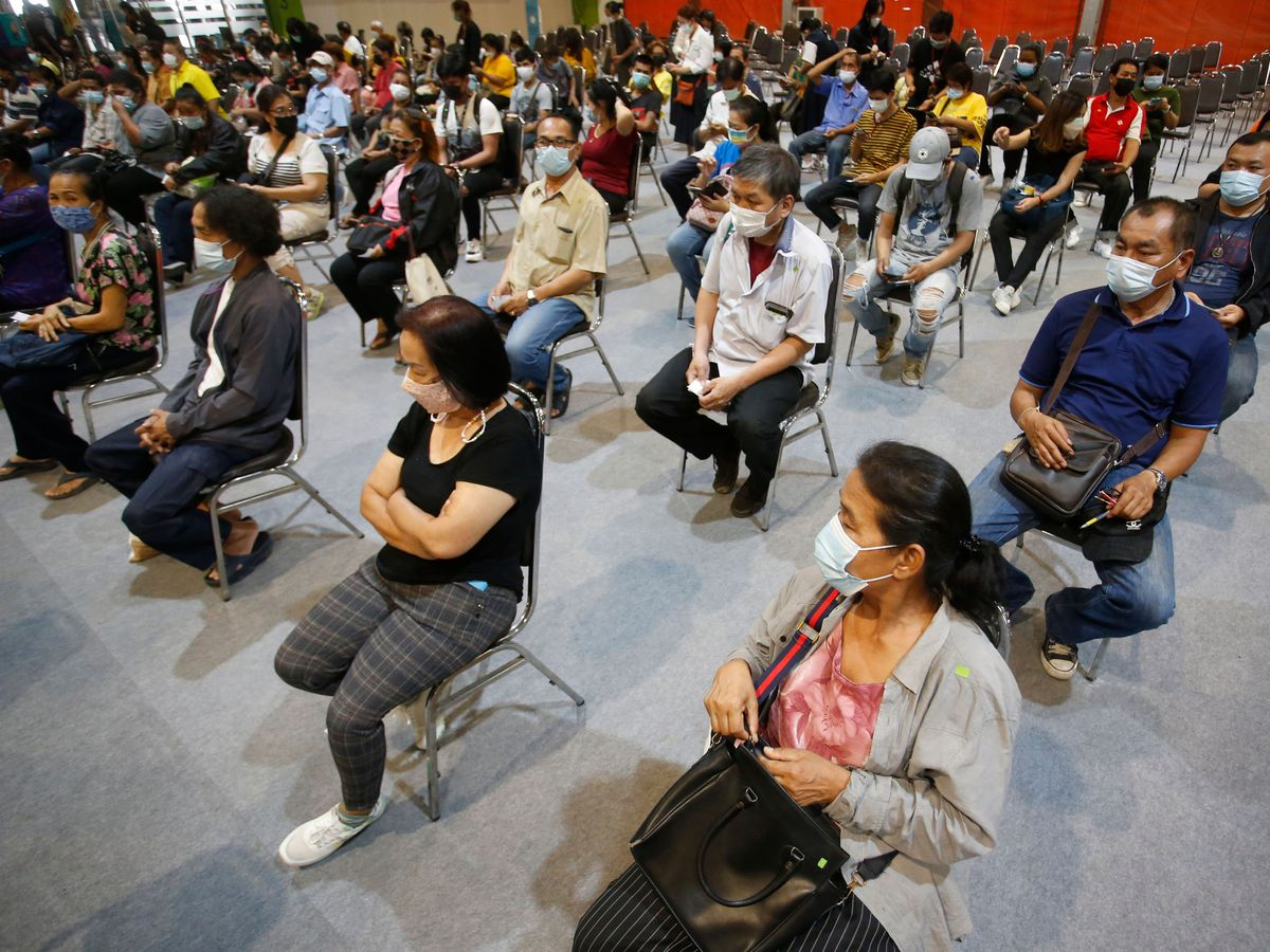 People wait to receive a Covid jab in Bangkok, Thailand