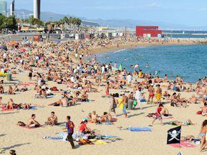 Holidaymakers on Platja Nova Icarie beach in Barcelona, Spain