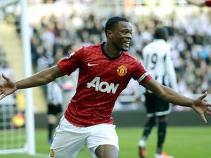 Manchester United's Patrice Evra celebrates while playing for Manchester United