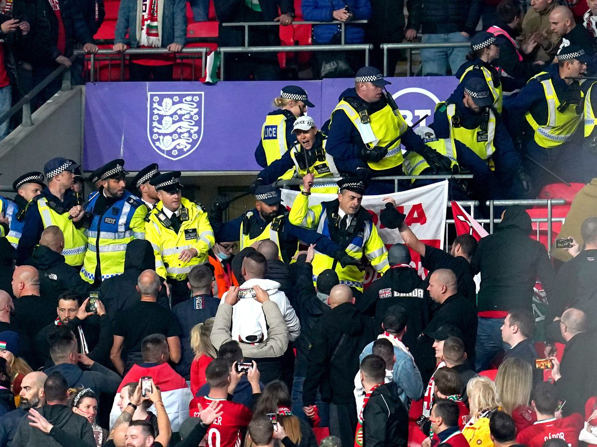 Hungary fans clash with police officers at Wembley during Tuesday night's World Cup qualifier against England