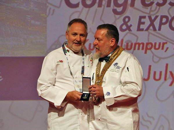Culinary Association of Wales president Arwyn Watkins, OBE, (left) with Worldchefs' president Thomas Gugler.