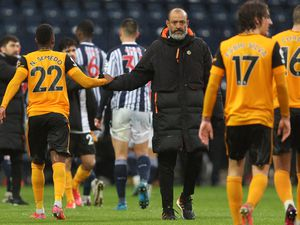 Nelson Semedo of Wolverhampton Wanderers shakes hands with Nuno Espirito Santo the head coach / manager of Wolverhampton Wanderers at full time.