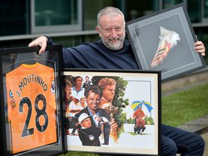 Organiser Mark Hands displays some of Wolves memorabilia and lots available at the auction