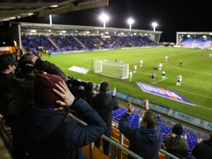 Fans of Shrewsbury Town react as a chance is missed. (AMA)