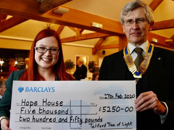 Rachel Lewis [Hope House] with President Nick Burn of the Rotary Club of Telford Centre