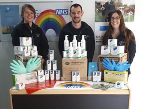 Nikki Weynburg, Darrel Dovey and Sarah Pearce from the company with the donations