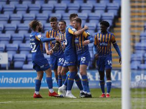 Josh Vela of Shrewsbury Town celebrates with his team mates after scoring a goal to make it 2-1.