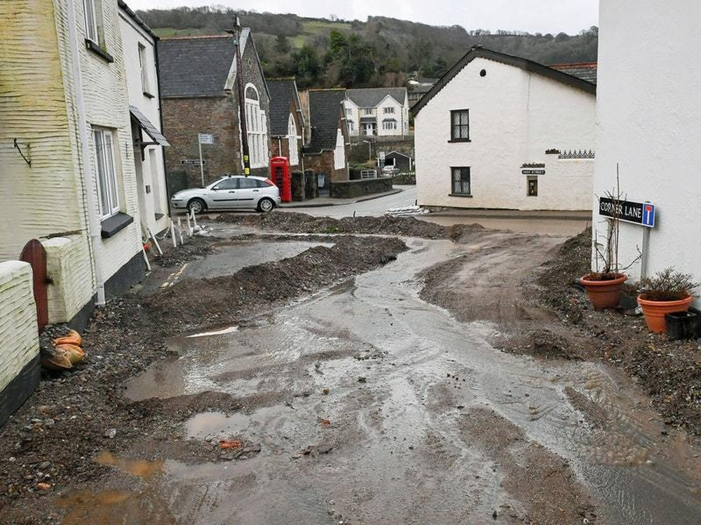 Homes EVACUATED as rain sparks LANDSLIDE in 'widespread flooding'