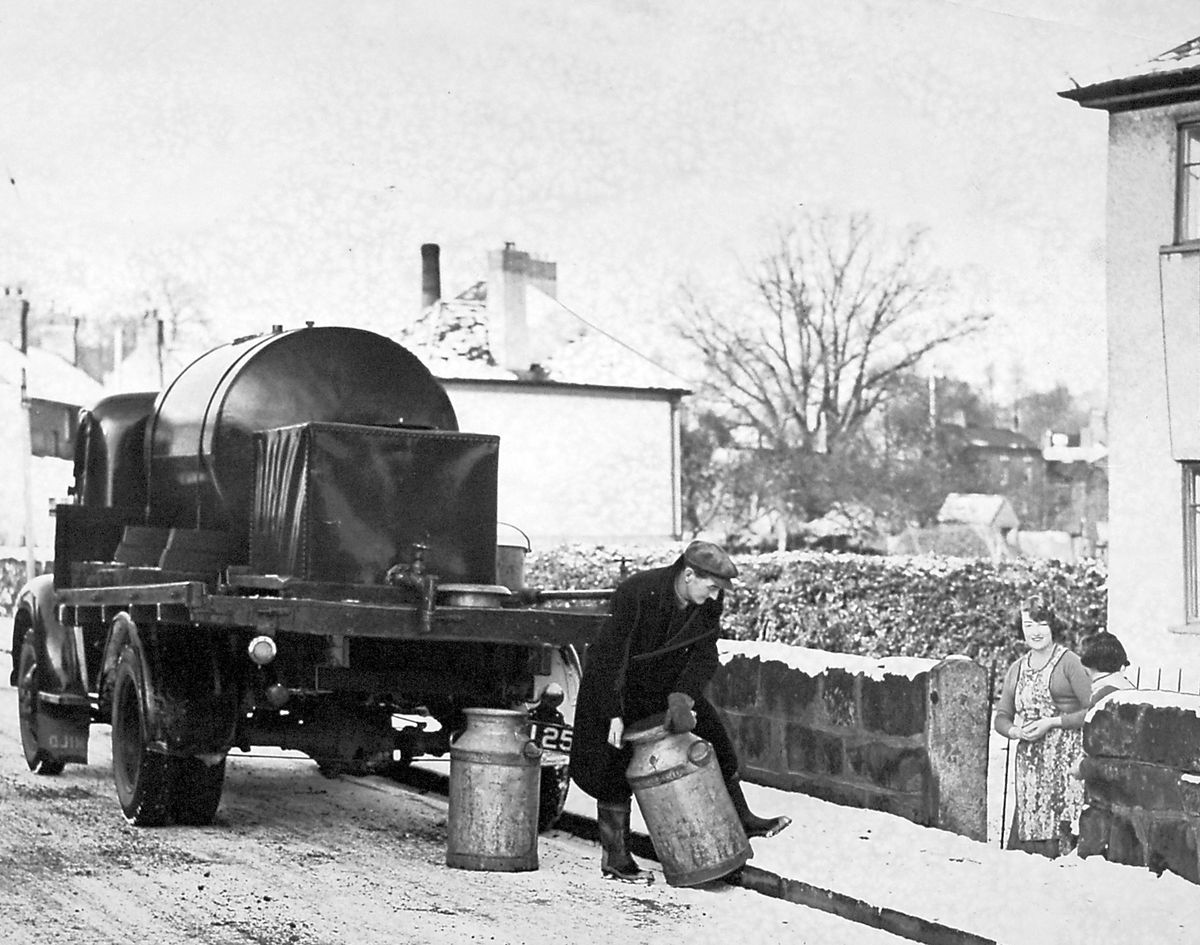 In the late 1950s a water tank visited the village of Ruyton-XI-Towns, where there was a water shortage, twice weekly to deliver water to the villagers at a cost of a halfpenny a gallon. The churns held 12 gallons and this had to satisfy villagers' requirements for three days. This print from our archives has a datestamp for January 1957, but confusingly also for January 1958. At a guess January 1958 is correct and somebody had forgotten to wind on the 1957 datestamp at the start of the new year. We're not sure if the shortage was a specific problem, or a general disadvantage of living in the village.