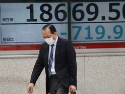 Asian shares continue to feel brunt of coronavirus pandemic