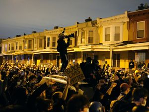 Hundreds of demonstrators marched in West Philadelphia over the death of Walter Wallace
