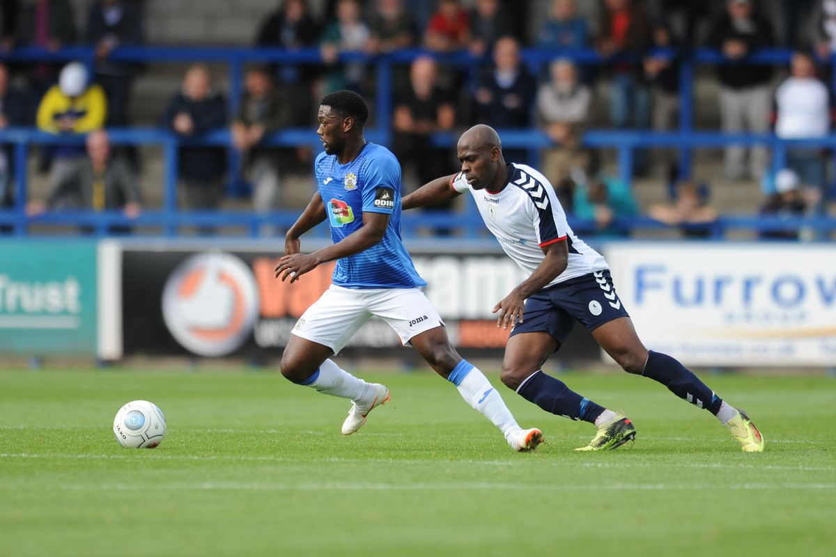 Darren Stephenson of Stockport battles for the ball with Theo Streete