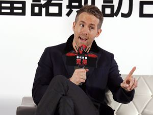 """Canadian actor Ryan Reynolds answers questions during a news conference for his new film """"Deadpool"""" Friday, Jan. 22, 2016, in Taipei, Taiwan. The film """"Deadpool,"""" based on a Marvel Comics character, will open in Taiwan early February. (AP Photo/Wally Santana)."""