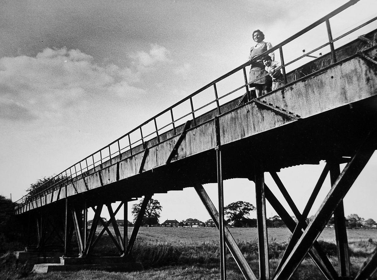 "The original caption to this photo from our files which was taken on September 18, 1974, read: ""Taking time off in the autumn sunshine to have a look at Thomas Telford's iron aqueduct which spans the River Tern at Longdon-on-Tern are Mrs Mary Fenton, of Oakengates, and four-year-old Adrian Miles, of The Store, Longdon."""