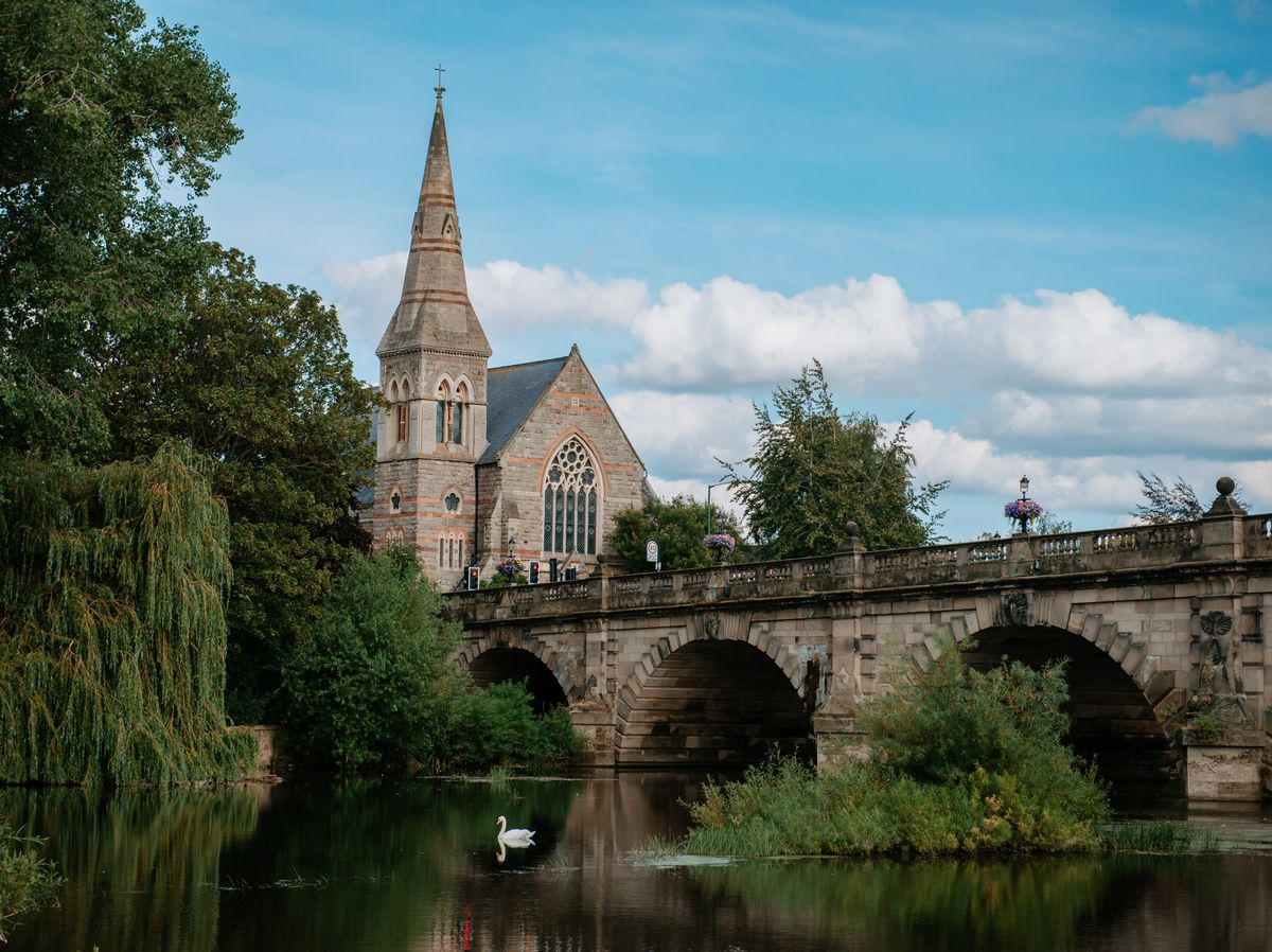 Work is being carried out to reduce vegetation beneath Shrewsbury's English Bridge