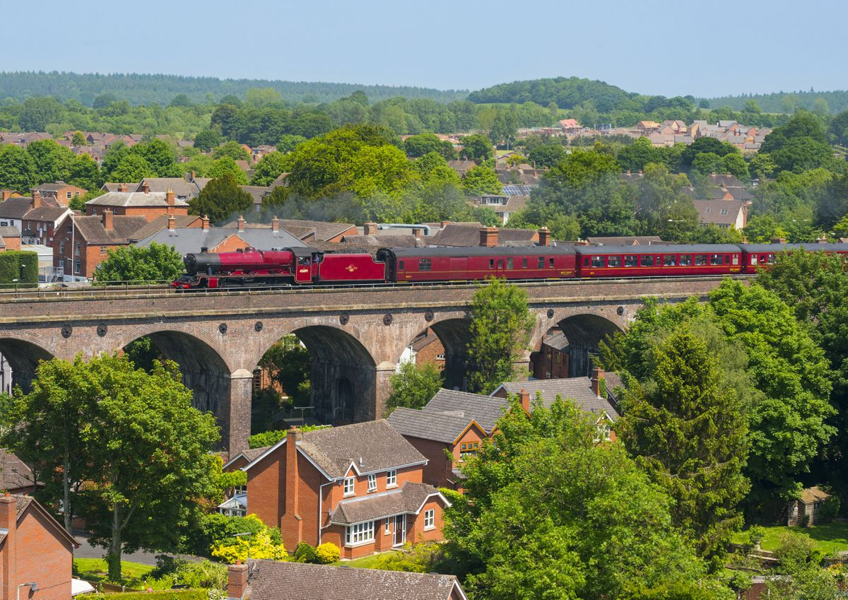 LMS Jubilee Class 45699 Galatea steam locomotive pulls the Cambrian Coast Express through Shifnal.