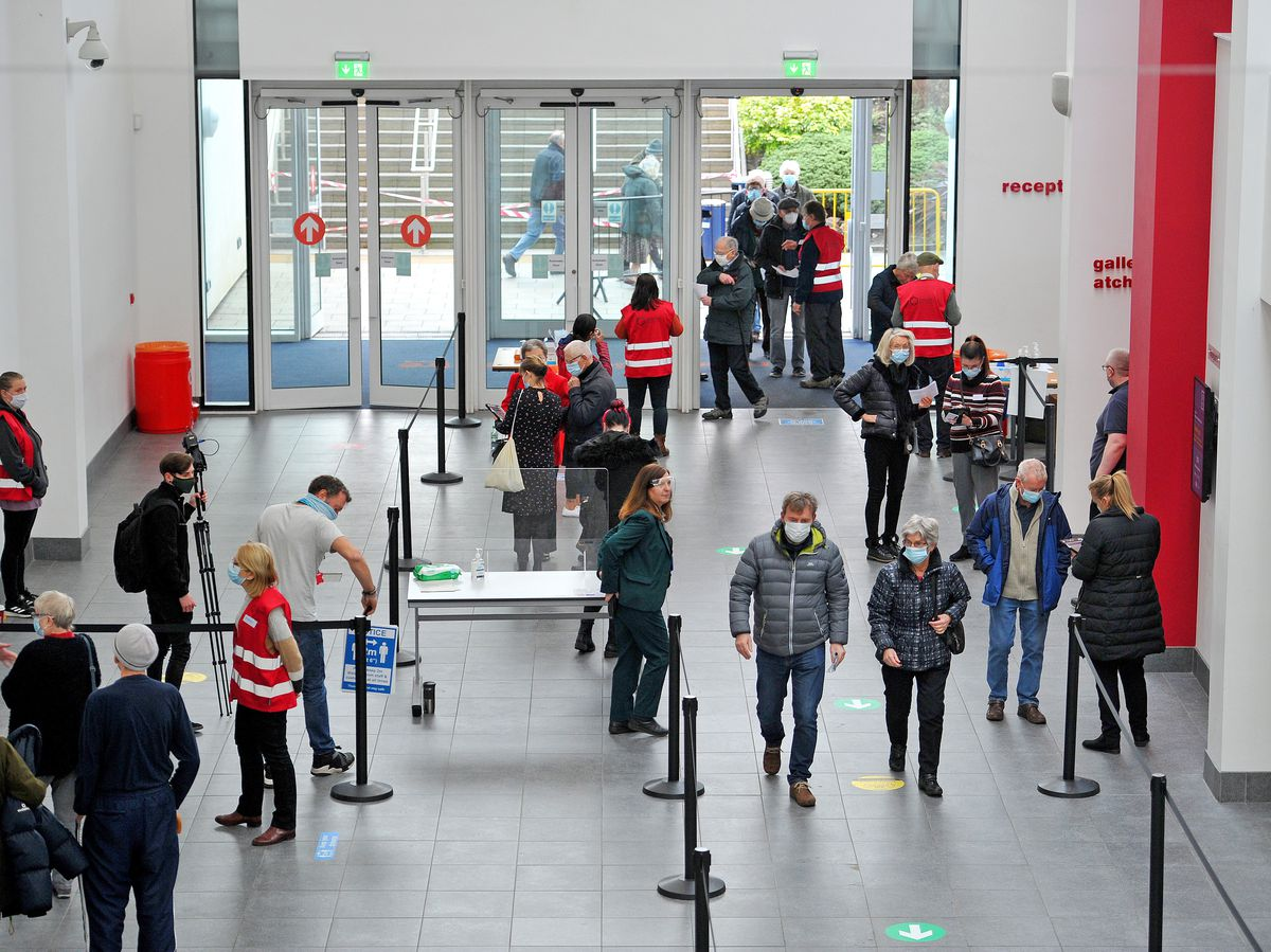 Members of the public arrive to be vaccinated at Telford International Centre