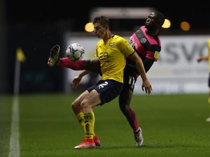 Dan Udoh of Shrewsbury Town and Steve Seddon of Oxford United (AMA)