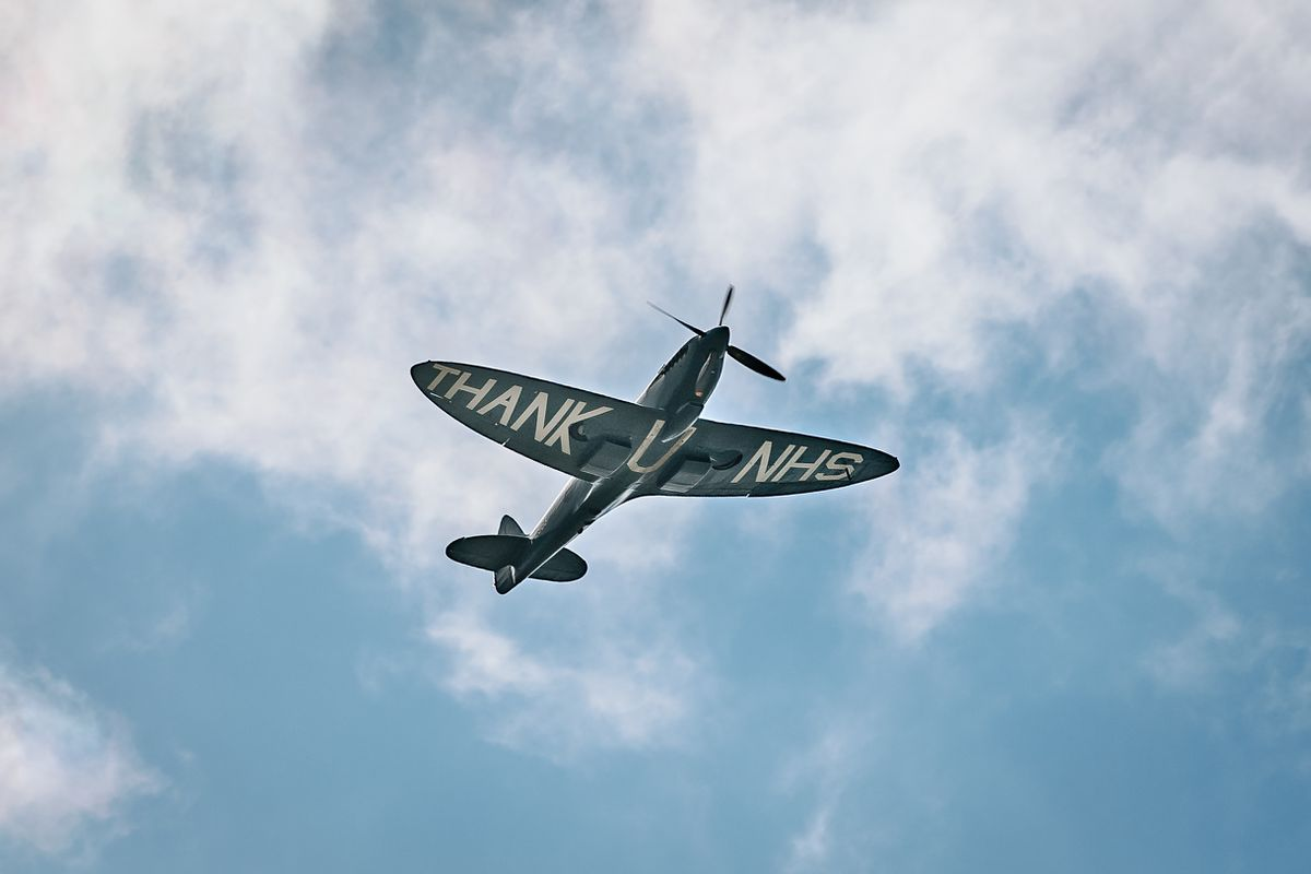 """The """"Thank U NHS"""" Spitfire as it flew over The Princess Royal Hospital this morning"""
