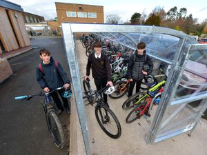 Priory School students Ben Hall, Ollie Hodgson and Ieuan Williams with the new bike sheds
