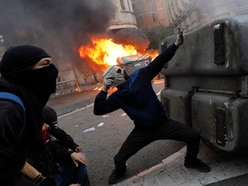Police use rubber bullets, tear gas, against Barcelona protesters