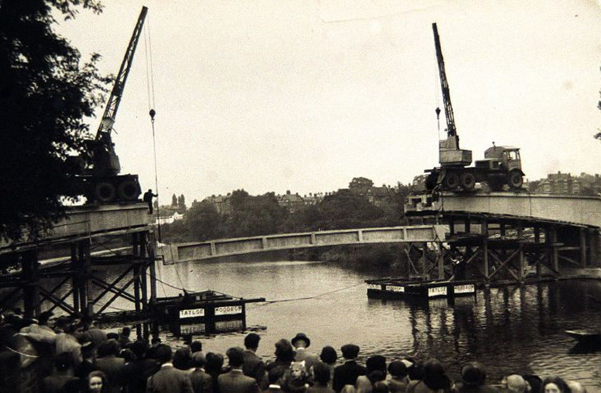 Easy does it... The erection of the Castle Walk footbridge, Shrewsbury. This picture is undated but seems to be the putting in place of the central span. The bridge was built in 1951. The 237ft bridge was the first of its kind in the country to be built with pre-stressed and tensioned reinforced concrete.