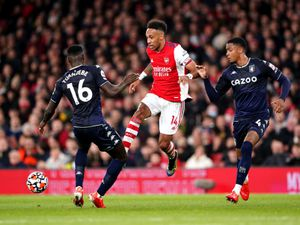 """Arsenal's Pierre-Emerick Aubameyang (centre) battles for the ball with Aston Villa's Axel Tuanzebe (left) and Ezri Konsa during the Premier League match at the Emirates Stadium, London. Picture date: Friday October 22, 2021. PA Photo. See PA story SOCCER Arsenal. Photo credit should read: Zac Goodwin/PA Wire. ..RESTRICTIONS: EDITORIAL USE ONLY No use with unauthorised audio, video, data, fixture lists, club/league logos or """"live"""" services. Online in-match use limited to 120 images, no video emulation. No use in betting, games or single club/league/player publications.."""