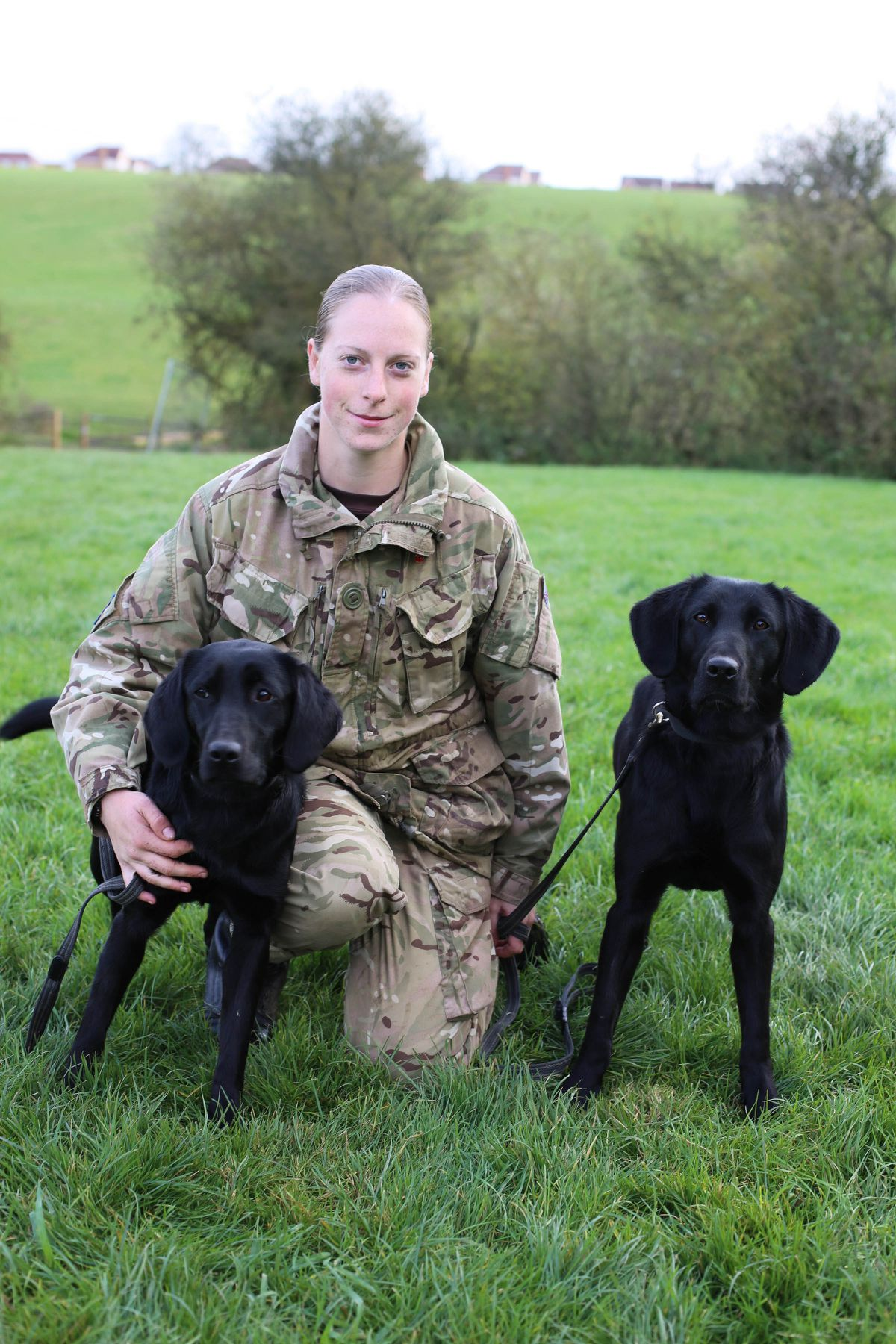 Private Kate Nicholas serving in the Royal Army Veterinary Corps, with Georgie and Gonzo.