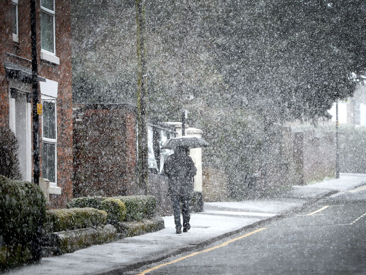Pedestrians brave the snow in Whitchurch town centre