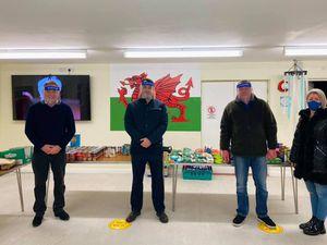 Simon Baynes and volunteers at the foodbank