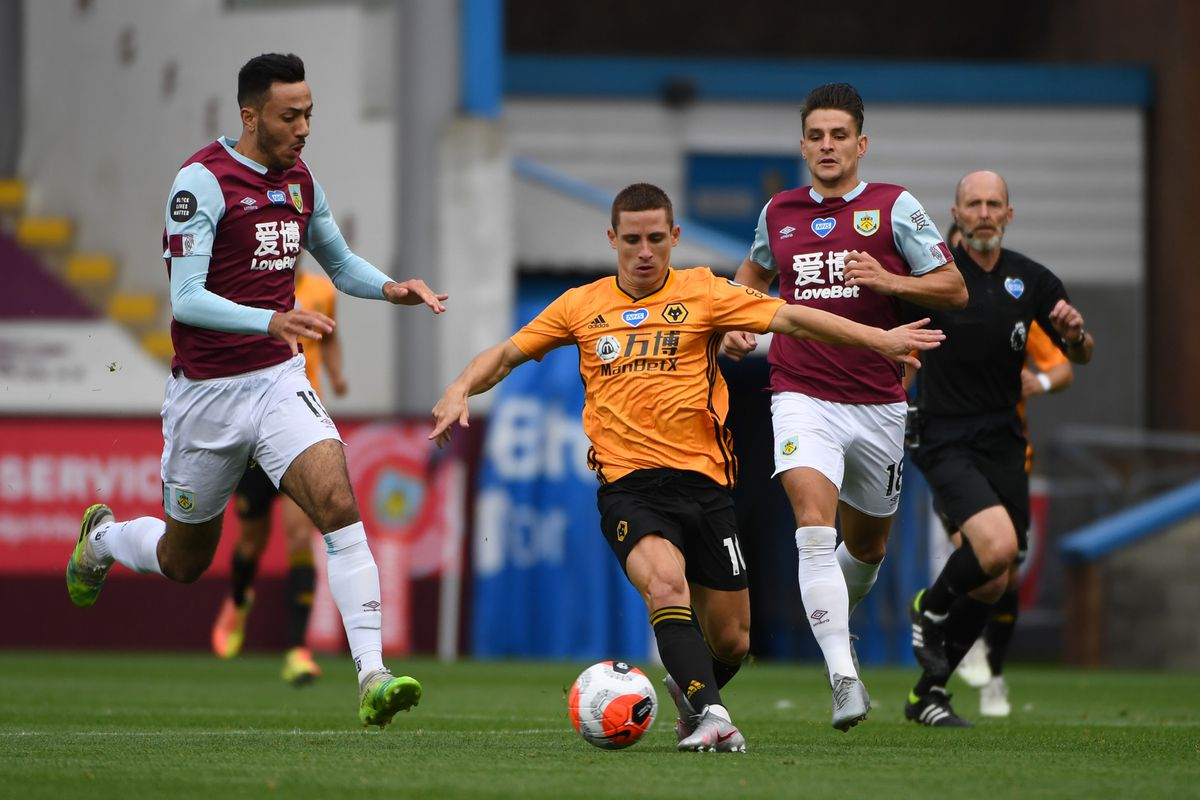 Dwight McNeil and Ashley Westwood of Burnley close in on Daniel Podence of Wolverhampton Wanderers. (AMA/Sam Bagnall)