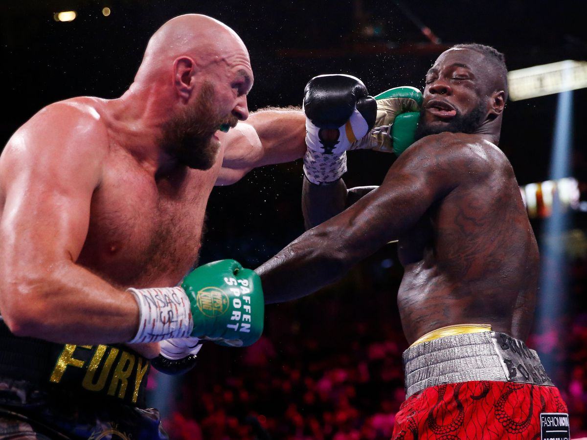 Tyson Fury (left) hits Deontay Wilder during their heavyweight fight in Las Vegas