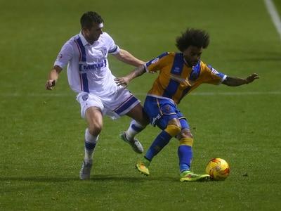 Shrewsbury sign midfielder Doug Loft