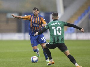 Charlie Daniels of Shrewsbury Town on his debut and Alex Newby of Rochdale. (AMA)
