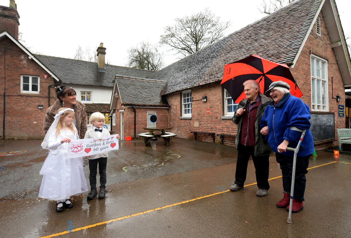 LGordon and Annis Tonkinson celebrate their diamond wedding anniversary at Sheriffhales Primary School, with six year olds Eva Pemberton and Harry Davenport-Williams, who dressed as a bride and groom in honour of their anniversary..