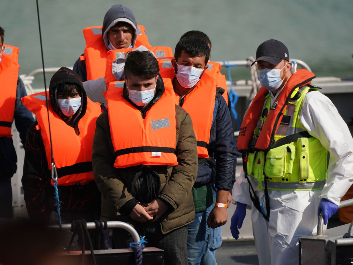 A group of people thought to be migrants are brought into Dover, Kent, by a Border Force patrol boat