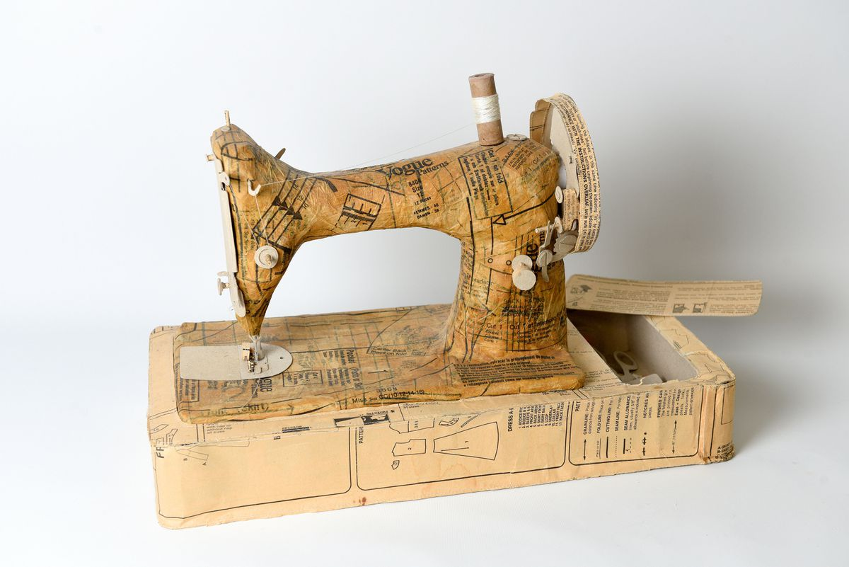 A sewing machine made from old dressmaking patterns