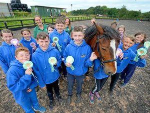 Alveley Primary School pupils proudly show off their rosettes after getting riding lessons at KA Horses Equestrian Centre