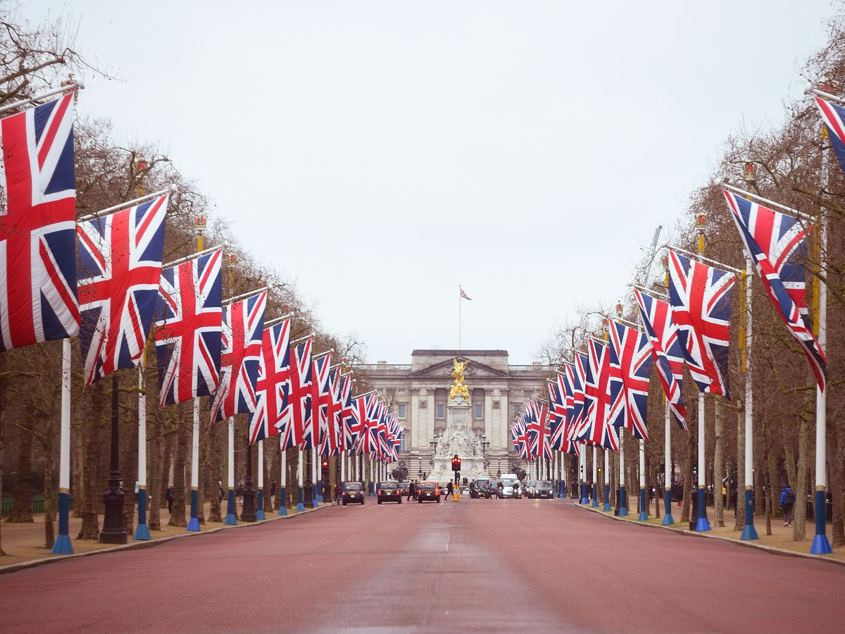 Union flags line The Mall leading to Buckingham Palace (Kirsty O'Connor/PA)