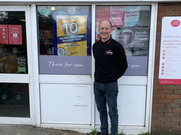 Matthew Jones outside his shop