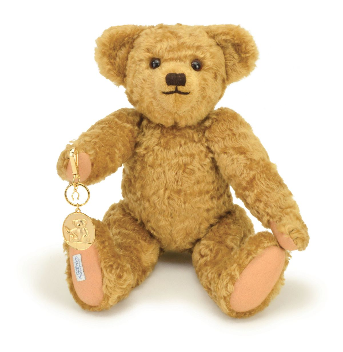 One of the Edward bears with the commemorative gold-plated keyring