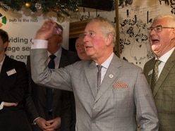 Charles takes a tipple and grabs the arrows in pub visit