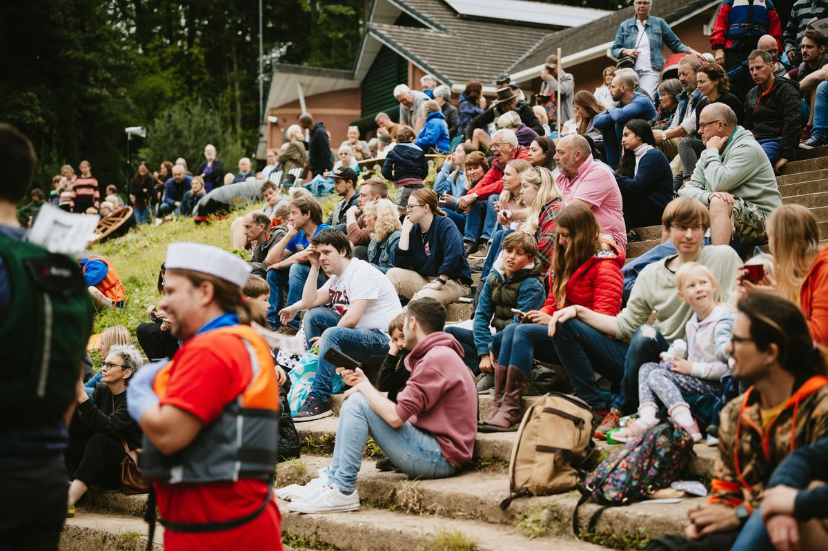 Crowds sat on the steps to watch the Ironbridge Coracle Regatta.