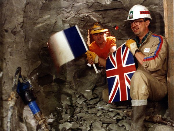 English tunneller Graham Fagg (left) exchanged flags with Frenchman Philippe Cozette as the two sides of the Channel Tunnel joined in 1990.