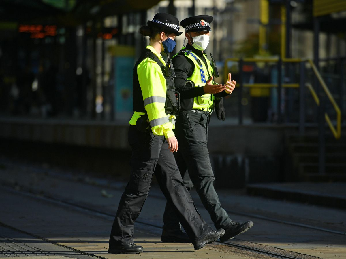 Police officers in facemasks