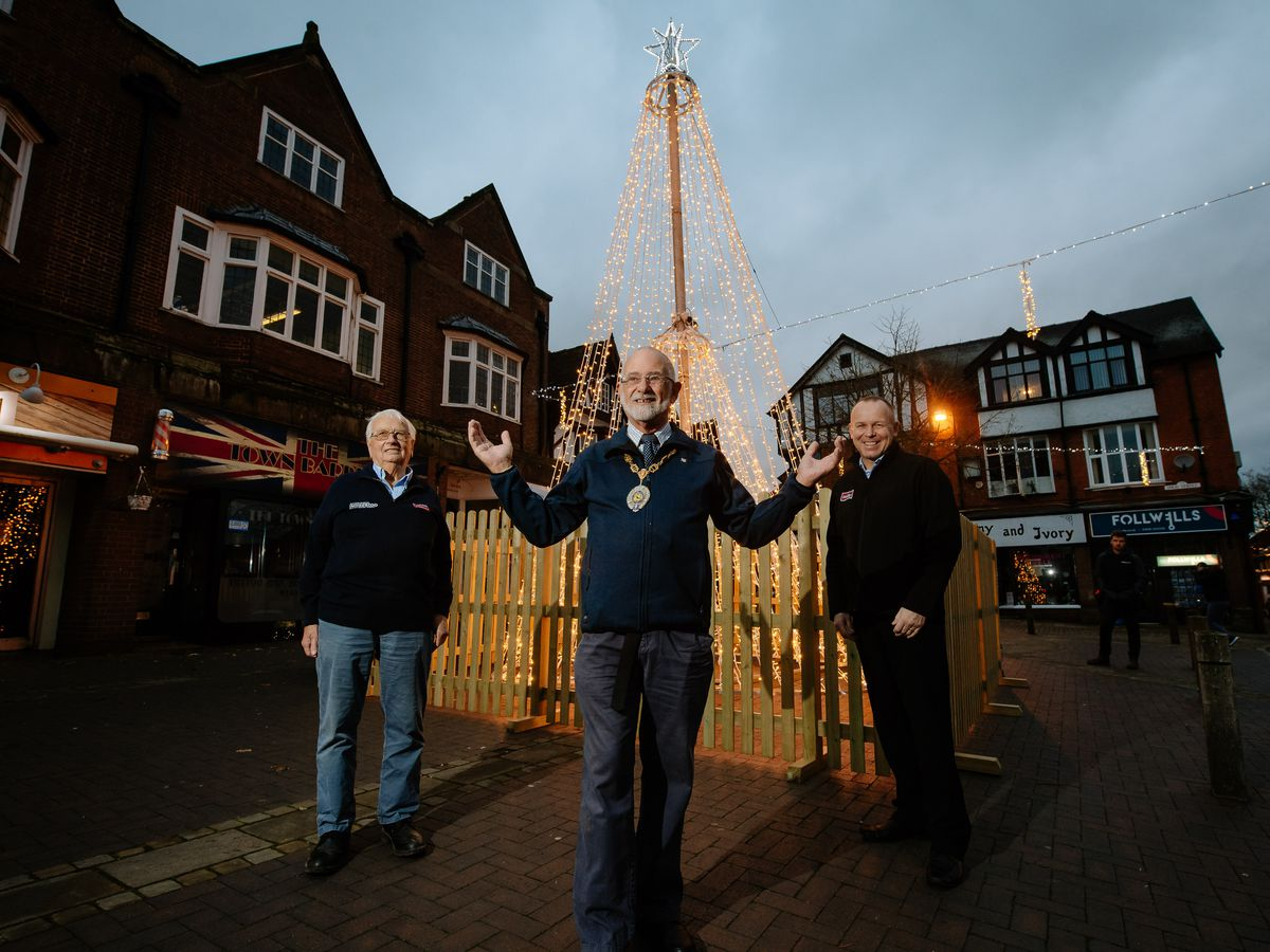 From left with the impressive new tower of light is Bill Parton of Hales Sawmills, mayor Roy Aldcroft and Jon Bentley from Müller