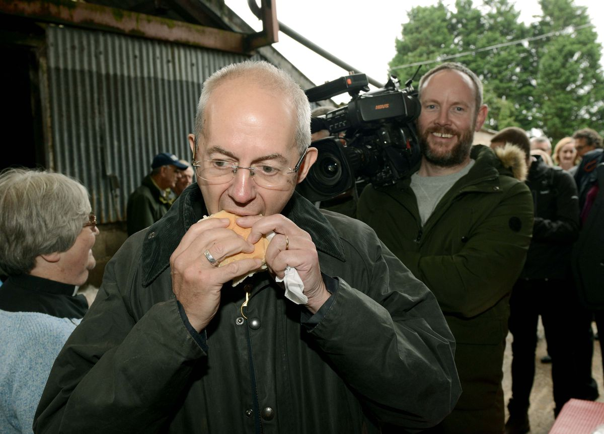 The Archbishop of Canterbury, Justin Welby, tucks into a bacon bap